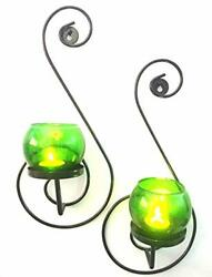 Set of 2 S-Shaped Tea-Light Holder for Home Decor with Green Votive Glasses.