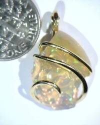 11.77ct African Crystal Opal In 14kt Gold Art Wire Wrap Pendant