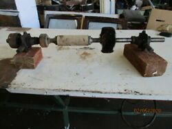 Old lineshaft driven shoe repairpolishinggrindingbuffing wheels on a shaft