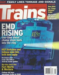 TRAINS Jan 2011 College Kids Hop Passenger Trains in 1940 EMD Rising G975