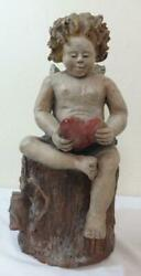 Unusual Antique Painted Redware Pottery Figure Of Cupid Holding A Heart On Stump