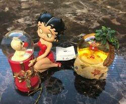 2 Betty Boop Snow Globes, Betty And Pudgy And Hula Betty