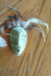 4 Alaskan Stone Carved Mask With Feathers. Signed Norman On The Back.