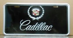 Cadillac License Plate W/ Rivoted On Crest And Sheild