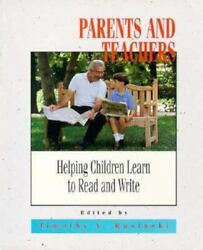 Parents And Teachers Helping Children Learn To Read And Write