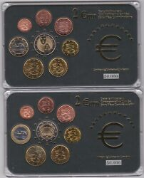 Two Cased Finland Eight Coin Euro Sets In Near Mint Condition.