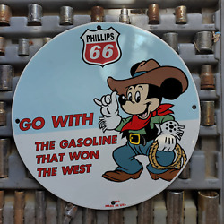 Vintage 1960 Phillips 66 Gasoline And039cowboy Mickey Mouseand039 Porcelain Gas-oil Sign