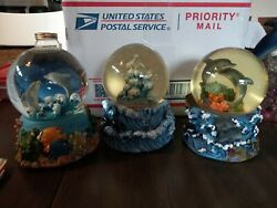 Beautiful But Imperfect Dolphin Musical Snow Globes