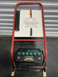 Original Autolite Battery Charging Station And Green Top Battery