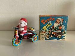 Tin Tricycle With Santa Dolls