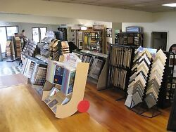 Flooring Store : Product displays warehouse equipment and inventory