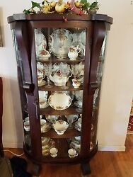 Antique Curved Glass Front China Cabinet With Full China Set.