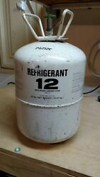 R12 refrigerant weighs 26 lbs. Has 21 lbs in it.