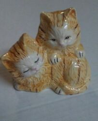 Ceramic cat figurine. Yellow long haired mother and kitten. no makers mark.