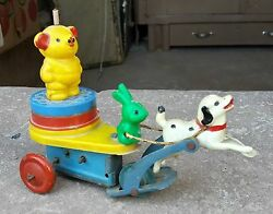 Vintage Dog Carrying Rabbit And Bear On Sleigh Tin And Bakelite/plastic Wind Up Toy