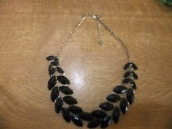 DRAMATIC BLACK AND GILT NEKLACE WITH MAQUISS SHAPED STONES