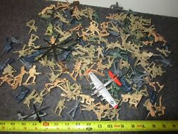 A Vintage Lot Of Assorted Plastic Toy Soldiers And A Metal Helicopter And Airplane