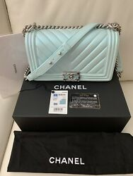 Authentic Boy Chanel iridescent Metallic lambskin with resin Close Lock SOLD OUT