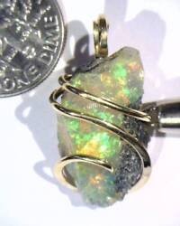 15.61ct African Crystal Opal In 14kt Gold Art Wire Wrap Pendant