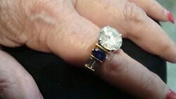18KT.YELLOW GOLD CUSTOM DESIGN RING WITH OVAL TANZANITES &TAPERED BAGDIAS-