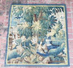 An Almost Square 18th Century Verdure Tapestry With Duck And Fountain