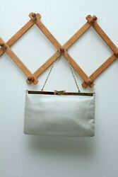 Vintage Etra silver clutch with gold accent has handle $20.00