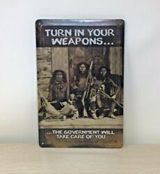 Funny Tin Sign Turn In Your Weapons The Government Will Take Care of You 8x12 In