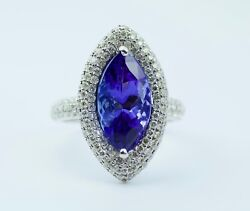 14k White Gold Aaa+ Marquise Shape Tanzanite With A Halo Of Diamonds Ring