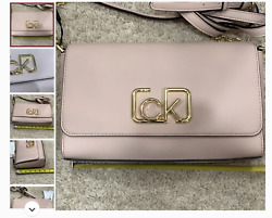 Brand new Calvin Klein pink bag with tags with defect MSRP 168$ $38.00