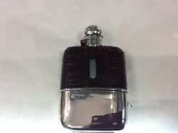 A Silver And Leather Whiskey Flask