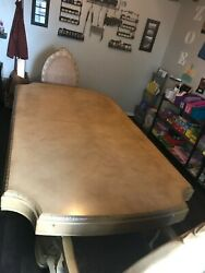 Large Antique Tan Colored Dining Table With Two Chairs And Two Leaves