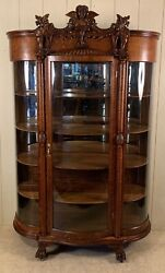 Antique Oak Curved Glass China Cabinet With Carved Ladyand039s Head And Griffins