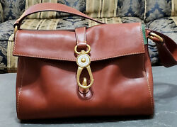 Dooney amp; Bourke beautiful Mint Libby Hobo in color Ginger Florentine leather. $150.00