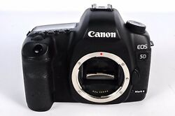 Canon Eos 5d Mark Ii With 50mm Lens And External Flash