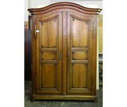 Important  wardrobe , paneled, curved, in walnut wood and dating back to 1700.