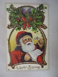 VINTAGE EMBOSSED CHRISTMAS POSTCARD SANTA READING A LETTER WITH GLITTER 1913