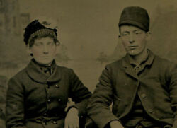 Handsome Couple In Hats And Woolen Coats, Living On The Edge. Tinted Tintype.