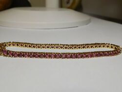 14kt yellow gold 5.00 ctw Ruby Tennis Box Style Size 7 Inch bracelet