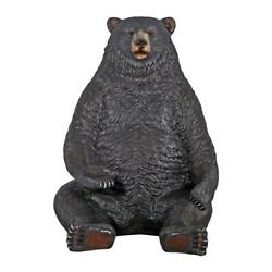Design Toscano Sitting Pretty Oversized Black Bear Statue with Paw Seat