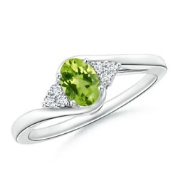 0.59ctw Oval Peridot Bypass Ring With Trio Diamond Accents In 14k Gold/platinum