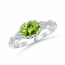 Oval Peridot Vintage Style Ring With Diamond Accents In 14k Gold/platinum