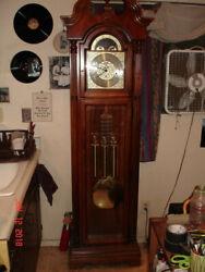 1994 Howard Miller Tall Case Grandfather Clock. Looks And Works Great.make Offer