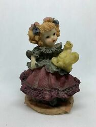 Vintage Figurine Girl Holding Stuffed Duck Toy