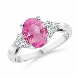 Oval Pink Sapphire Cocktail Ring With Trio Diamond Accents In Gold/platinum