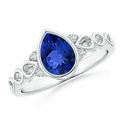 Bezel Set Vintage Pear Tanzanite Ring With Diamond Accents In Gold/platinum