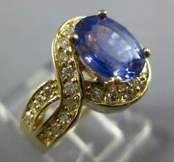 2.86ct Diamond And Sapphire 14kt Yellow Gold Oval And Round Infinity Engagement Ring