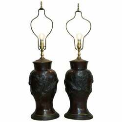 Pair Of Vintage Chinese Export Bronze Table Lamps With Dragons And Floral Decor
