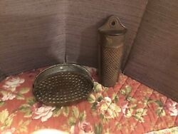Two Antique Nutmeg Metal Graters Hang On The Wall And Hand Held Grater