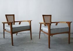 Pair Of Mid Century Walnut And Cane Lounge Chairs By William Hinn