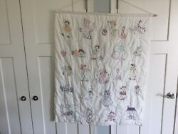 Hand embroidered children's wall hanging quilt background is white 36 x 44 pr